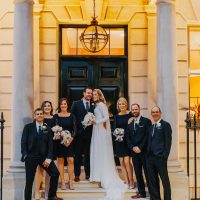 The-In-and-Out-royal-navy-military-club-wedding-ceremony-reception-couple-entrance